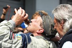 Klaus Abbelen celebrates third place