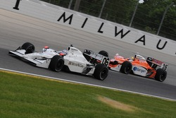 Graham Rahal running ahead of Enrique Bernoldi