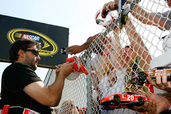 Tony Stewart signs autographs