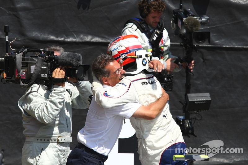 Race winner Robert Kubica celebrates with Dr. Mario Theissen