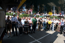 Fans watch the Aston Martin Racing Aston Martin DBR9 unload