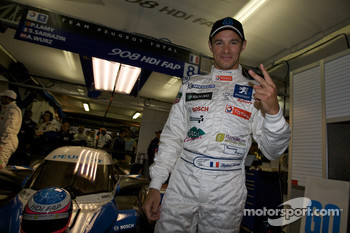 Pole winner Ste_phane Sarrazin celebrates