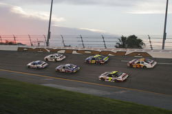 Brad Keselowski and Bryan Clauson lead a group of cars