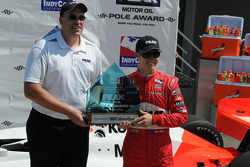Ryan Briscoe receives his pole trophy