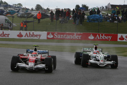 Timo Glock, Toyota F1 Team, TF108 and Rubens Barrichello, Honda Racing F1 Team, RA108