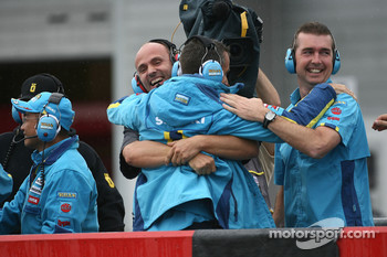 Suzuki team members celebrate third place of Chris Vermeulen