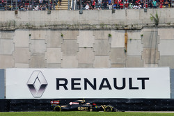 Pastor Maldonado, Lotus F1 E23 passes a Renault advertising hoarding