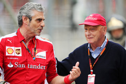 (L to R): Maurizio Arrivabene, Ferrari Team Principal with Niki Lauda, Mercedes Non-Executive Chairman