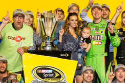 Victory lane: race winner and 2015 NASCAR Sprint Cup series champion Kyle Busch, Joe Gibbs Racing Toyota celebrates with wife Samantha and baby Brexton