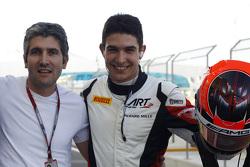 Esteban Ocon, ART Grand Prix celebrates pole position with his dad