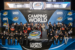 Championship victory lane: NASCAR Camping World Truck Series 2015 champion Erik Jones, Kyle Busch Motorsports celebrates with team owner Kyle Busch and his team