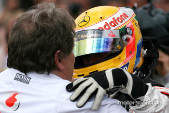 Race winner Lewis Hamilton celebrates with Norbert Haug