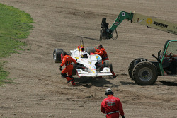 Mario Dominguez sits in his car as a fork lift removes him from the gravel pit