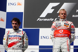 Podium: race winner Heikki Kovalainen, second place Timo Glock