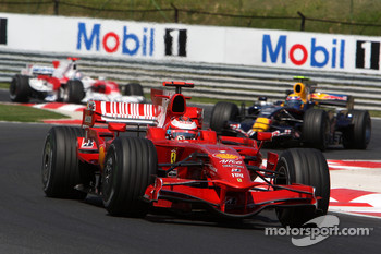 Kimi Raikkonen, Scuderia Ferrari, F2008 leads Mark Webber, Red Bull Racing, RB4