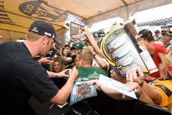 Clint Bowyer signs autographs for fans during the Jack Daniels Experience