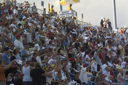 Fans get ready for the start of the race