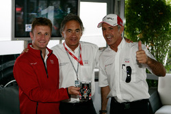 Allan McNish, Jürgen Pippig and Rinaldo Capello after playing slot cars