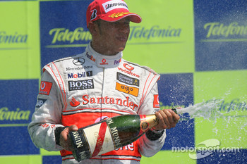 Podium: Lewis Hamilton celebrate with champagne