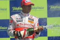 Podium: Lewis Hamilton celebrate with champagne