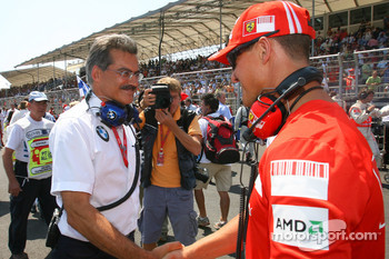 Dr. Mario Theissen, BMW Sauber F1 Team, BMW Motorsport Director and Michael Schumacher, Test Driver, Scuderia Ferrari