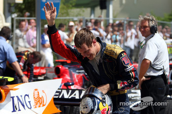 Sebastian Vettel celebrates 6th place