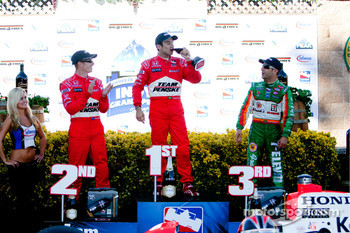 Race winner Helio Castroneves partakes of the local vino