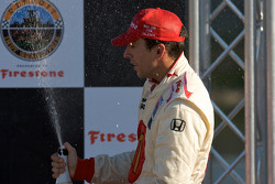 Podium: Justin Wilson sprays champagne