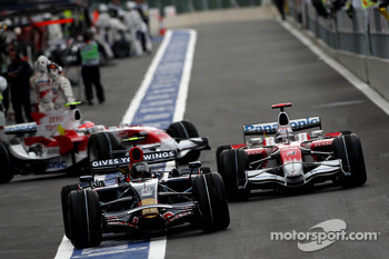 Sebastian Vettel, Scuderia Toro Rosso, STR03 and Jarno Trulli, Toyota Racing, TF108