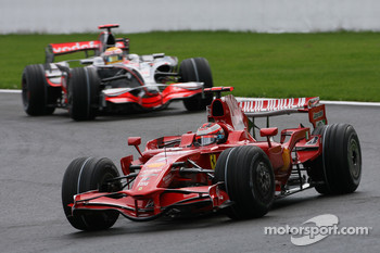 Kimi Raikkonen, Scuderia Ferrari, F2008 and Lewis Hamilton, McLaren Mercedes, MP4-23