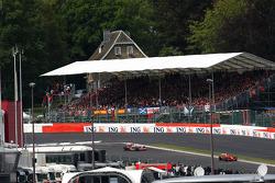 Kimi Raikkonen, Scuderia Ferrari, F2008 leads and Lewis Hamilton, McLaren Mercedes, MP4-23
