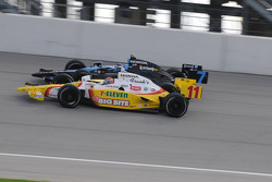 Tony Kanaan and Danica Patrick run together