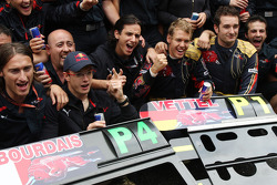 Pole winner Sebastian Vettel celebrates with Sébastien Bourdais and his team