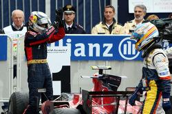 Race winner Sebastian Vettel celebrates with Fernando Alonso