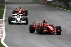 Kimi Raikkonen, Scuderia Ferrari, F2008 leads Nick Heidfeld, BMW Sauber F1 Team, F1.08