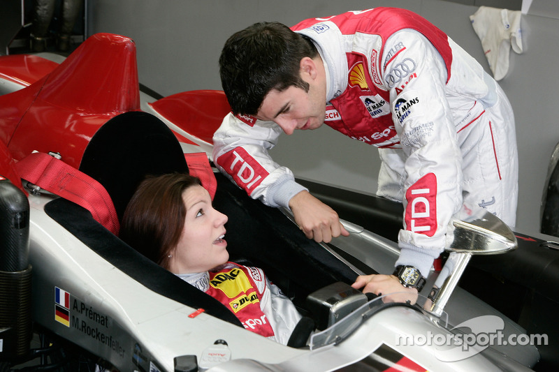 Mike Rockenfeller shows his Audi Sport Team Joest Audi R10 TDI to Katherine Legge