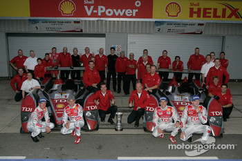 Race winner Allan McNish and Rinaldo Capello and Le Mans Series 2008 Champions Alexandre Prmat and Mike Rockenfeller celebrate with Dr. Wolfgang Ullrich and Audi Sport Team Joest team members