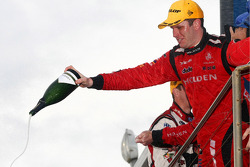 Podium: Garth Tander and Mark Skaife win the LandH 500