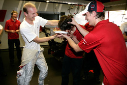 Audi Sport Team Phoenix team member Christoph Wagner gets a birthday cake from Alexandre Prémat and Oliver Jarvis