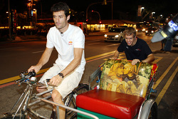 Mark Webber and Sebastian Vettel on their way to the Raffles Hotel