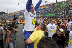 Yamaha team members celebrate Valentino Rossi's win and 8th World Championship