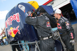 Red Bull Toyota crew members at work after a crash