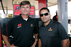 Juan Pablo Montoya talks with Ken Allen Jr. at one of Allen's R.K. Allen Oil Company in Talladega