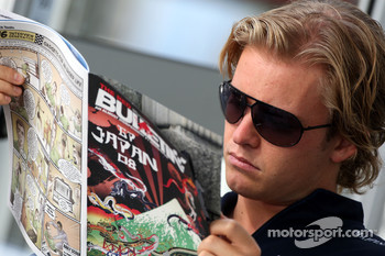 Nico Rosberg, WilliamsF1 Team reads the Red Bulletin