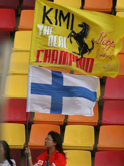 Kimi Raikkonen, Scuderia Ferrari flag and fan