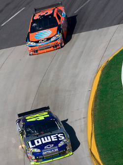 Jimmie Johnson leads Jeff Burton