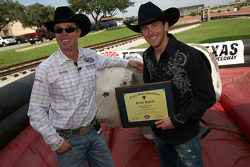 Former four-time bull riding champion Tuff Hedeman stands with NASCAR Sprint Cup Series driver Scott Speed after he received his