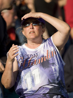 A Denny Hamlin fan watches on as Carl Edwards passed Denny Hamlin for the lead