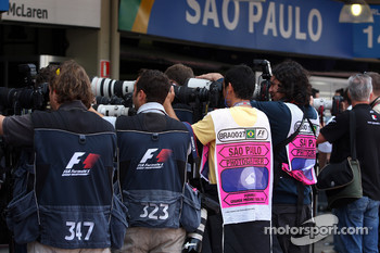 Photographers outside the McLaren garage