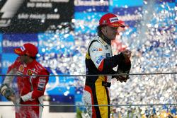 Podium: Fernando Alonso sprays champagne